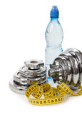 Concept of healthy lifestyle. Water, dumbbells, measuring tape Stock Photography