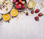 The concept of a healthy and wholesome breakfast, cereal with nuts and fruit place for text,frame wooden rustic background top Royalty Free Stock Photo