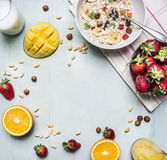 The concept of a healthy and wholesome breakfast, cereal with nuts and fruit place for text,frame wooden rustic background top Stock Photo