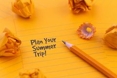 Concept Hello summer or planning a summer trip. Orange sheets of paper, pencil and other stationery objects.  royalty free stock images
