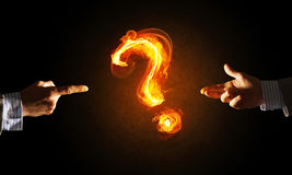Concept of help or support with fire burning question mark and creation gesture Royalty Free Stock Photo