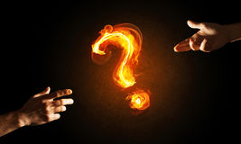 Concept of help or support with fire burning question mark and creation gesture Royalty Free Stock Photos