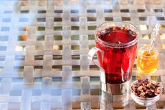 Concept of herbal tea. Hibiscus tea in a glass mug with honey. H Royalty Free Stock Photography