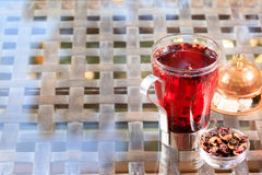 Concept of herbal tea. Hibiscus tea in a glass mug with turkish. Locum. Healthy caffein-free drink. Neutral background. Horizontal Stock Photo