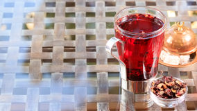 Concept of herbal tea. Hibiscus tea in a glass mug with turkish. Locum. Healthy caffein-free drink. Neutral background. Horizontal, wide screen format Stock Photography