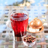 Concept of herbal tea. Hibiscus tea in a glass mug with turkish. Locum. Healthy caffein-free drink. Neutral background. Square Stock Photography