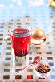 Concept of herbal tea. Hibiscus tea in a glass mug with turkish. Locum. Healthy caffein-free drink. Neutral background. Vertical Stock Photography