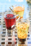 Concept of herbal tea. Variety of herbal teas in glass mugs. Hea Royalty Free Stock Photography