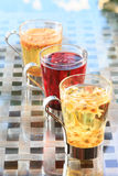 Concept of herbal tea. Variety of herbal teas in glass mugs. Hea Stock Images