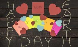 Concept heureux de jour de terre 22 avril, salutation de signe de message sur des autocollants Image stock