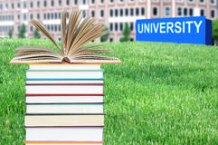 Concept of higher education. Book, campus, university stock photo