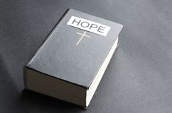 Concept of Holy Bible as a symbol of Hope. Antique,background,belief,believe,big,black,book,catholic royalty free stock photo