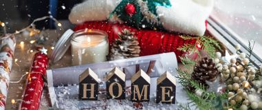Concept of Home and comfort. Christmas decor Warm sweater, candles, Christmas tree. Word Home. Winter mood, Cozy Home