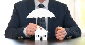 Concept of home coverage. Symbol of home coverage by a general agent Stock Image