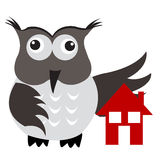 Concept of home insurance with house under owl wing protection Royalty Free Stock Photo