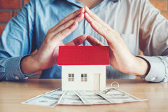 The concept of home ownership and dollars bills.  Stock Image