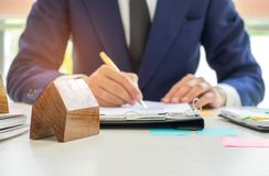 Concept home purchase contract,Businessmen are signing a house p Royalty Free Stock Photo
