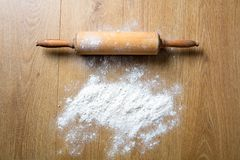 Concept of homemade cooking with rolling pin spread with flour Stock Photography