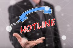 Concept of hotline. Hotline concept above the hand of a man in background Royalty Free Stock Photos