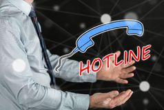 Concept of hotline. Hotline concept above the hands of a man Royalty Free Stock Image