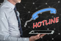 Concept of hotline. Hotline concept above a tablet held by a man Royalty Free Stock Photo
