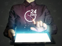 Concept of 24-hour support. Image of a girl with tablet pc in her hands and 24-hour support service icon. Concept of 24-hour support Royalty Free Stock Photos