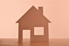 Concept of house  in paper centered on wood front Royalty Free Stock Photos