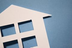 Concept of house in paper on wall. Horizontal composition. Top view. Concept of house in paper on wall. Horizontal composition. Top view royalty free stock photo