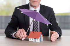 Concept of house protection coverage Stock Photo