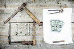The concept of a house under construction. Old wooden desktop. Old rusty carpentry tools Stock Photo
