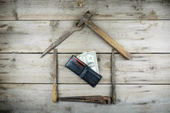 The concept of a house under construction. Old wooden desktop. Old rusty carpentry tools. Horizontal mockup Royalty Free Stock Photo