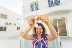 Concept of housewarming, real estate, property and moving - New home owner with key.  Royalty Free Stock Photos