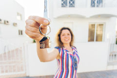 Concept of housewarming, real estate, property and moving - New home owner with key.  Royalty Free Stock Images