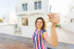 Concept of housewarming, real estate, property and moving - New home owner with key.  Royalty Free Stock Photo