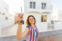 Concept of housewarming, real estate, property and moving - New home owner with key Stock Photos