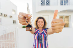 Concept of housewarming, real estate, property and moving - New home owner with key Stock Image