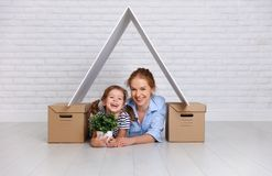 Concept of housing, mortgage and relocation family mother and ch Stock Images