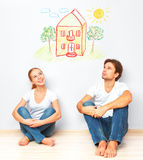Concept: housing and mortgage for young families. couple dreami. Concept: The housing and mortgage for young families. couple dreaming of his home stock photo