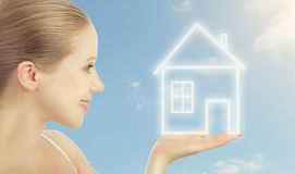 Concept housing. woman holding a house Stock Photo