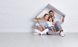 Concept housing a young family. mother father and children in n. Concept housing a young family. mother father and children in a new home stock images