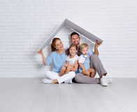Concept housing a young family. mother father and children in n. Concept housing a young family. mother father and children in a new home royalty free stock photography