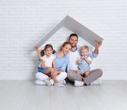 Concept housing a young family. mother father and children in  n Stock Images