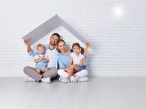Concept housing a young family. mother father and children in  n Stock Photo