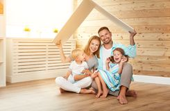Cept housing a young family. mother father and children in  new Royalty Free Stock Photos