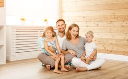 Concept housing a young family. mother father and children in  n Royalty Free Stock Photo