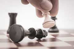 The pawn beats the king on a chess board Stock Photos