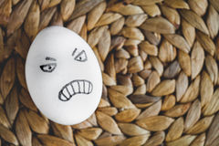 Concept human relationships and emotions eggs - anger Royalty Free Stock Image