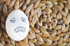 Concept human relationships and emotions eggs - anger Stock Image
