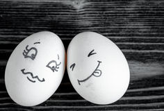 Concept human relationships and emotions eggs - romance. On dark wooden background Stock Images