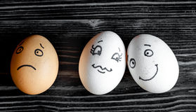 Concept human relationships and emotions eggs sadness. Concept human relationships and emotions eggs - sadness on dark wooden background Stock Photography